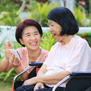 senior woman and a woman laughing