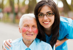 nurse and elder woman smiling
