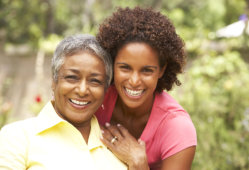 elder woman and a woman smiling