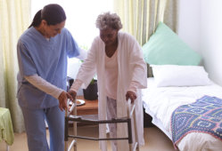 caregiver assisting the elder woman