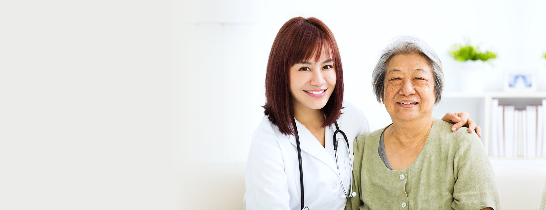 nurse and an elder woman smiling