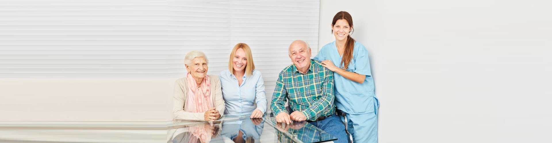 senior couple and two female caregivers