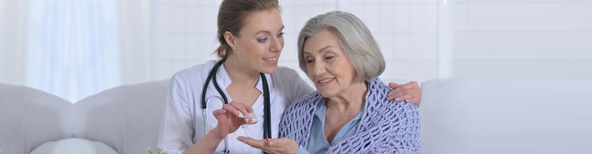 female nurse and senior woman