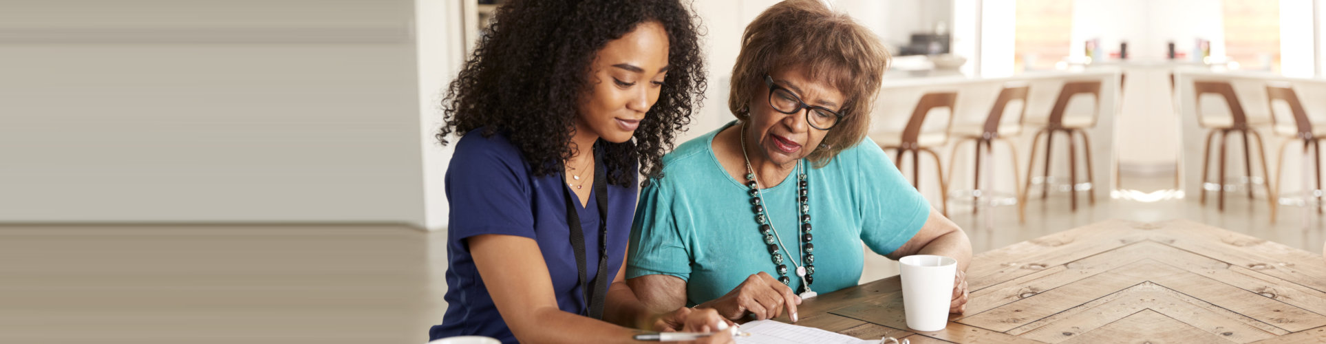 caregiver helping the elder woman